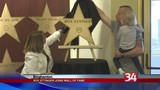 A gold star is unveiled to honor a guitarist and teacher